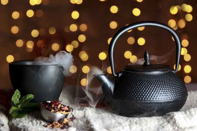 close up of black teapot
